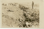 us-soldier-inspecting-war-dead