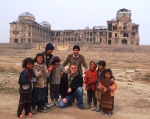 kids outside of Darulaman Palace