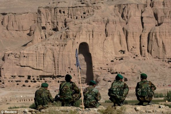 Afghan Soldiers gaze upon the remains of the Bamian Buddhas
